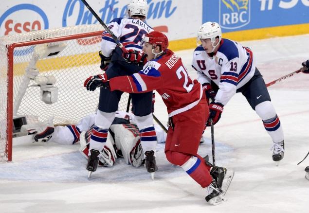 Егор Коршков забрасывает победную шайбу в ворота команды США. Фото: REUTERS