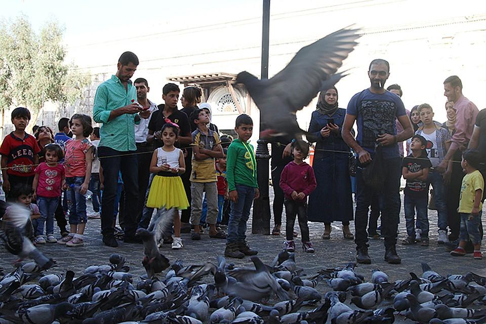 Картинки по запросу Спасибо, Россия: жители Сирии возвращаются к мирной жизни