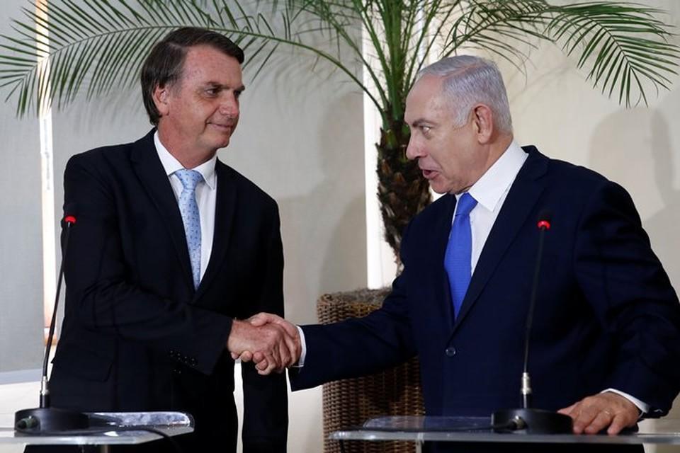 Избранный президент Бразилии Жаир Болсонару (слева) и премьер-министр Израиля Биньямин Нетаньяху