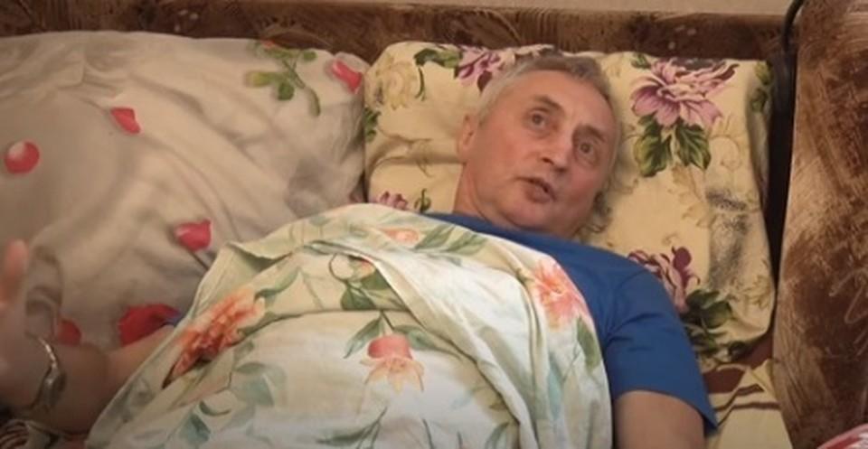 Валерий Жуган повредил спину, спасая людей из огня. Фото: скриншот видео