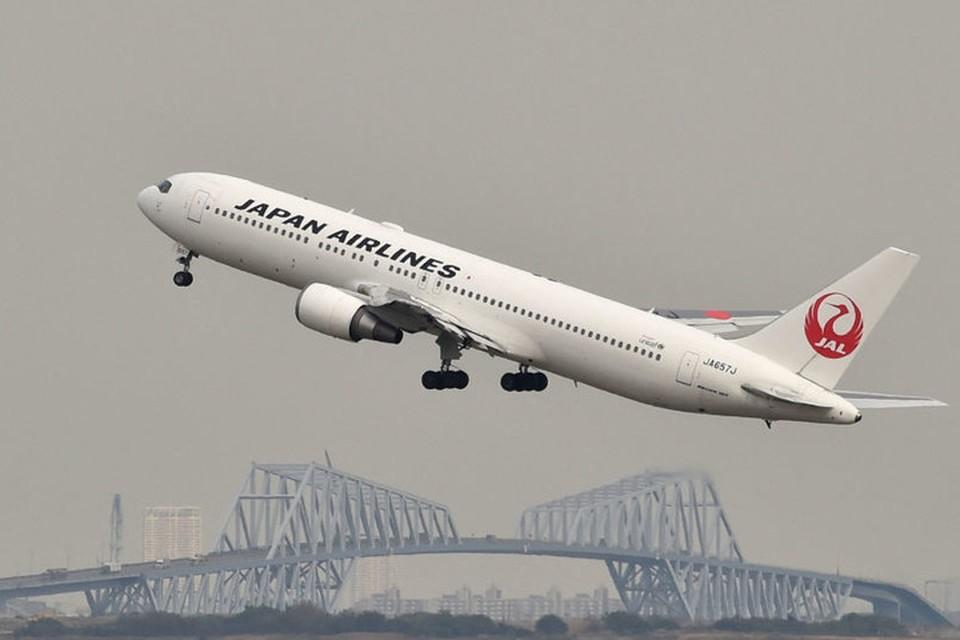 Правительство Японии рекомендует национальным авиакомпаниям не летать над Беларусью. Фото: © AFP 2021 / KAZUHIRO NOGI