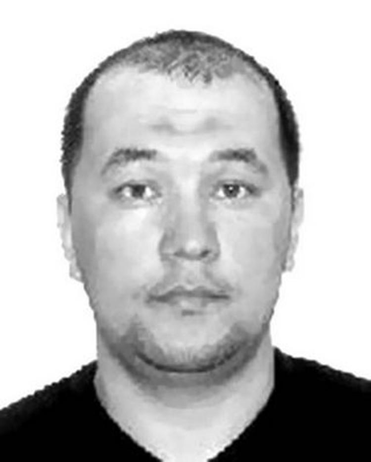 """Холик Субханов, убит сегодня, 1 августа, при перестрелке в здании Мособлсуда. Фото: Владимир Маркин """"Убийства, теракты, катастрофы. По следам кровавых преступлений""""/Репродукция"""
