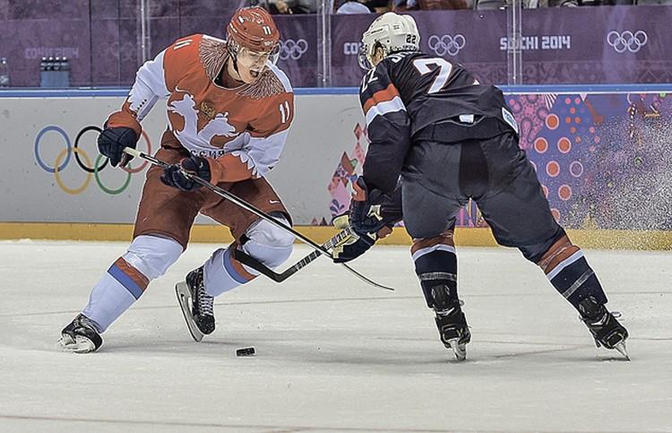 Евгений Малкин в олимпийском матче сборных России и США.